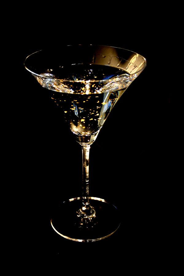 GOLD COCKTAIL RECIPE:  -2 1/2 oz Vodka  -1 1/2 oz Malibu Coconut Rum  -1 tsp shredded coconut  - Coconut flakes (for garnish)  -Edible gold powder (available at bakery/cake decorating outlets)