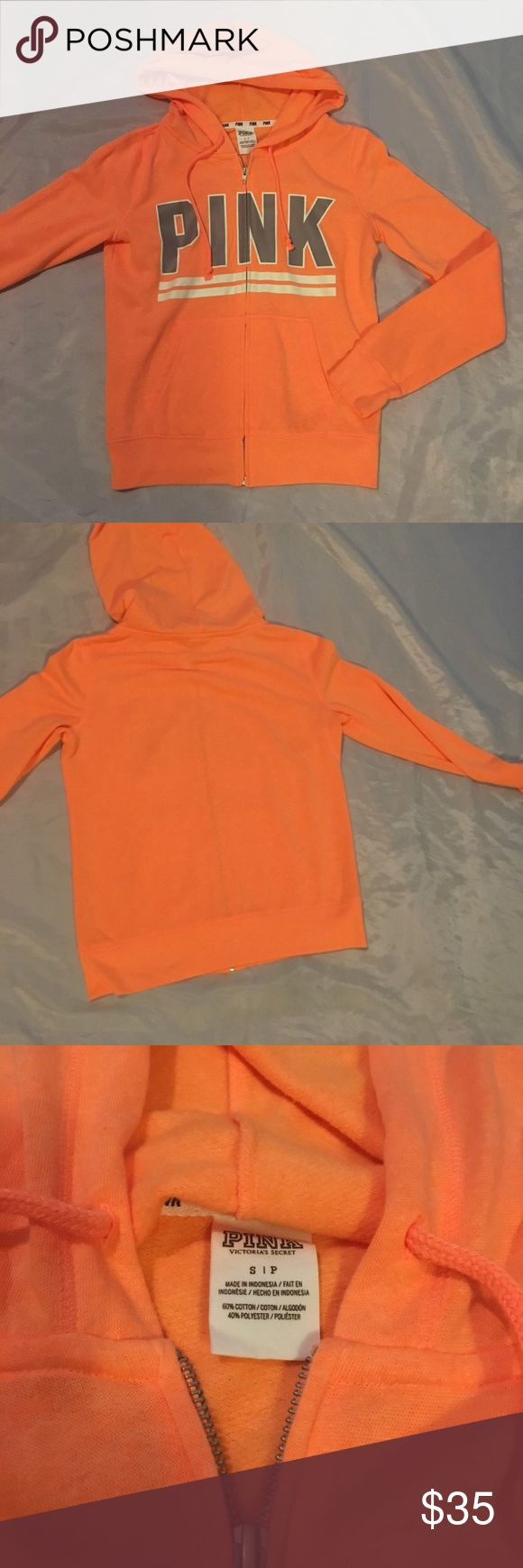 VS PINK neon orange zip-up hoodie NWOT neon orange size small zip-up hoodie ( could probably fit a medium also ) NO TRADES PINK Victoria's Secret Tops Sweatshirts & Hoodies