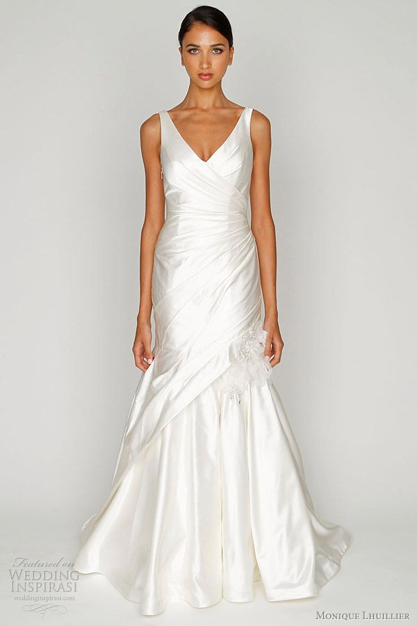 Satin V-neck gown with asymmetric draped bodice, modified trumpet skirt and embroidered detail. Bliss by Monique Lhuillier