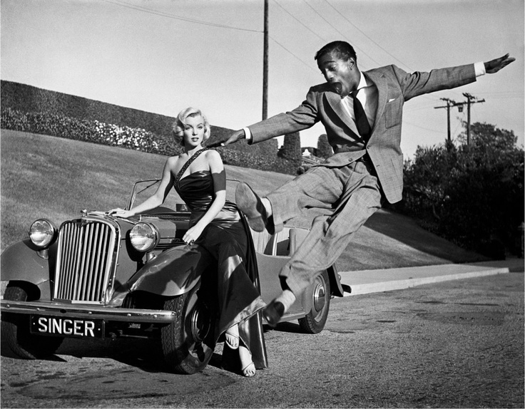 "Frank Worth, Sammy Davis, Jr. leaps for Marilyn Monroe on set of ""How to Marry a Millionaire"""