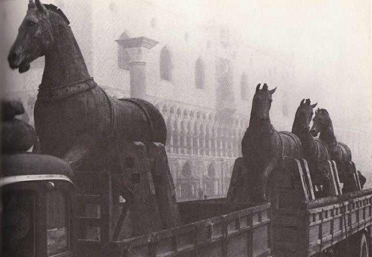 """They were transported to Paris and prominently displayed atop the Arc de Triomphe. Finally, in 1815, following Napoleon's defeat at Waterloo and his exile, the horses were winched down from the Arc de Triomphe and  ""shipped on a barge back to Venice, where they were reinstalled on the front balcony of St. Mark's Basilica."" 