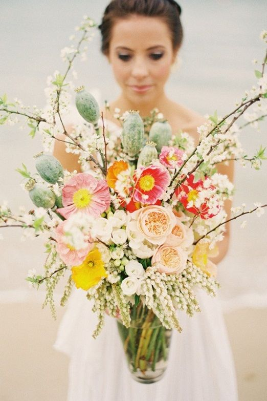 Blossom, poppy and seedhead bouquet ... love the blossom branches sticking out