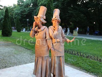 Living statue - french women happy at international festival of living statues in Bucharest, Romania.