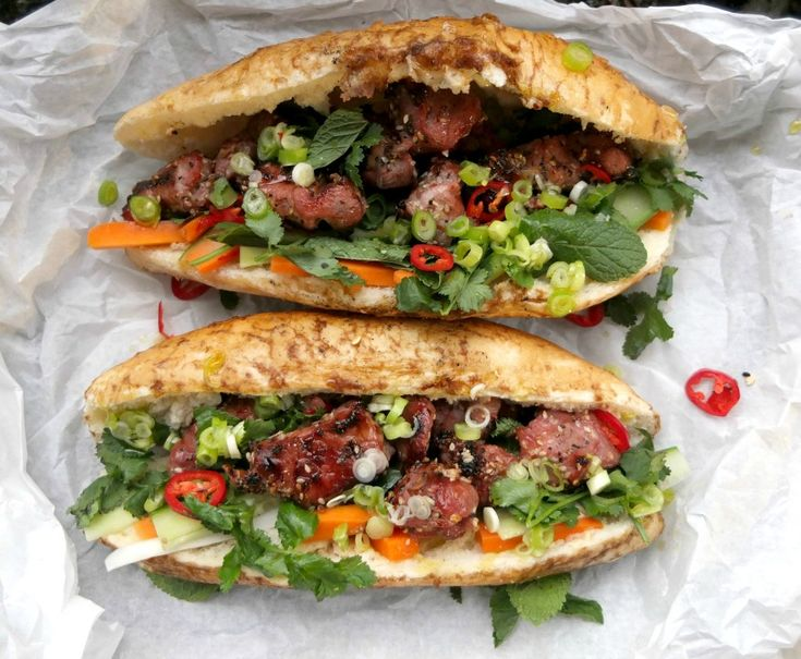 A recipe for grilled pork banh mi with a south London twist, using marinated pork shoulder, pickled vegetables, herbs, chilli and grilled baguettes.