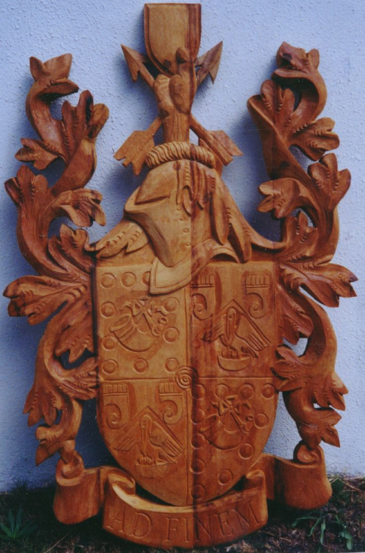 The Sign carver hand carved this Coat of Arms for the Hunting Family. Carved from Railway sleepers. http://www.signcarver.co.za/