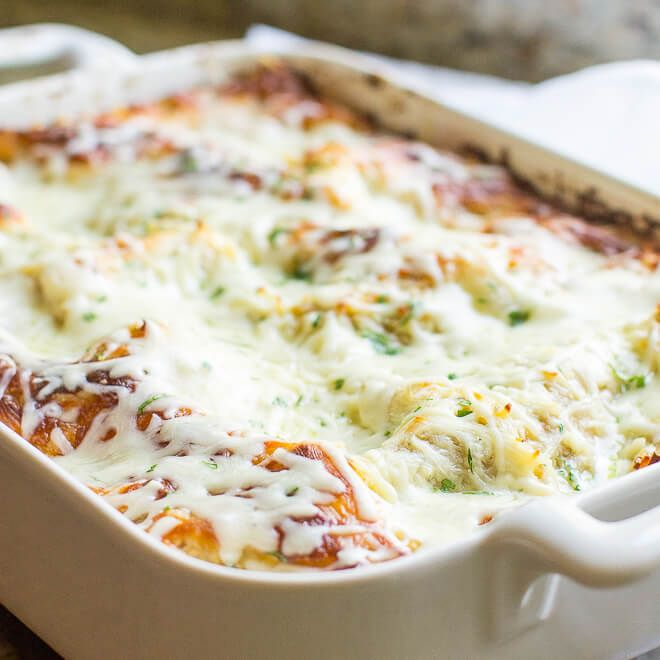The best Make Ahead Lasagna Recipe has a homemade meat sauce with beef AND sausage as well as THREE kinds of cheese. No need to boil the noodles ahead of time, either! Freezer-friendly.