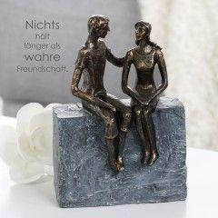 vriendschap - liefde tussen jongen en meisje beeld gemaakt van polystone, bronskleur