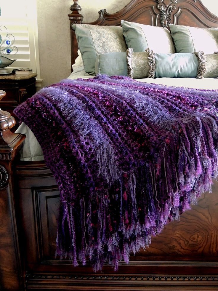 """Ports Charlotte Homebuilders """"Crochet throw - Finally finished!  I started out using left over yarns but of course needed to buy more and now have enough for another one! hehe!. All done in single crochet, I used Sashay (scarf yarn), Bernat Boa eyelash, Homespun Grape, Loops  Threads fabulous fur as well as a LT sequin yarn to trim. Unfortunately the metallic from the Sashay doesn't show in the photo. (throw is folded in half showing double 9"""" fringe) I love these chunky, soft and easy…"""
