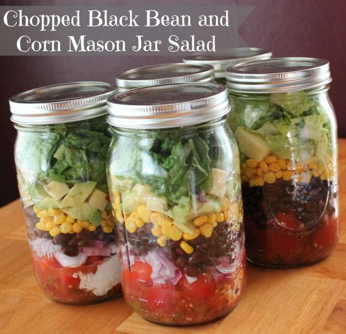 Mason Jar Salad Recipe Chopped Black Bean and Corn with Tomatoes, Avocados, Pepper Jack Cheese, Romaine Lettuce, Cilantro with Salsa and Greek Yogurt.