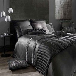 Kylie Minogue Cassia Bedding - bold and sophisticated, displays a beautiful ribbon ruffle detail to add a darkly glamorous touch to the black satin.
