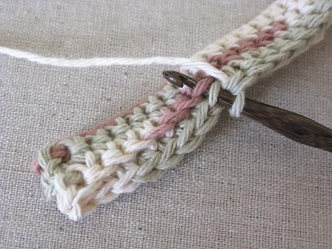 Double-thick crochet stitch: LOVE this technique!  Demonstrated to make thick hot pads but I'm making an ear warmer band, and am thinking about using it to make kennel pads for bigger dogs (that need more padding).