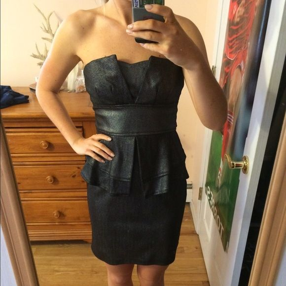 Peplum Going Out Dress Black and Metallic Silver going out dress. Great looking on all body types. Worn once. Perfect condition. Teeze Me Dresses Strapless