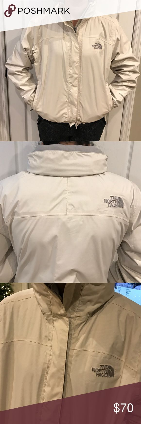 The North Face women's windbreaker XS White windbreaker with fold in hood. Bottom has elastic string tie and stretch cuffs. Inside lining grey netted. Zip up front with Velcro overlap closure. The North Face Jackets & Coats