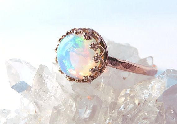Valentines Day sale is on!! Please use code HOLIDAY15 for 15% off all orders, thank you!!  A brilliant 8mm Round Opal is the stunning centerpiece of this ring. Set in a bronze crown bezel with a 14k rose gold fill band, the opals are so gorgeous with so much rainbow flash!! Perfect for stacking or wearing alone, this ring goes with everything! :) Band measures approx. 1.2mm wide.  Add a Rose gold stacking ring set: https://www.etsy.com/listing/181512684/rose-gold-ring...