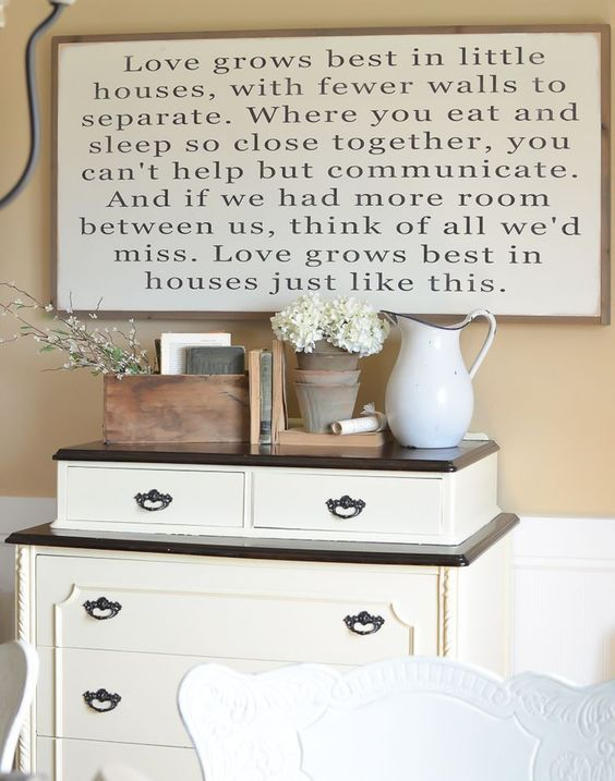 Love Grows Best in Little Houses Sign in farmhouse dining room. The Best Farmhouse Style Signs on Etsy.