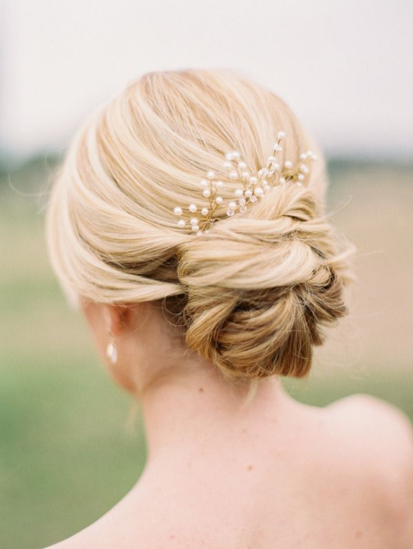 Pretty modern bridal bun wedding hairstyle