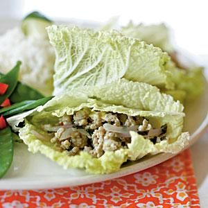 The ground chicken filling has seasonings similar to those in larb, a popular Thai appetizer. Add sticky rice and sautéed fresh snow peas with chopped red bell pepper to complete the meal. Squeeze a lime wedge over the chicken for extra zip.