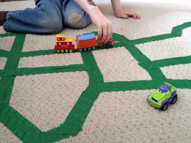 How adorable is this? Painter's Tape turned living room highway!