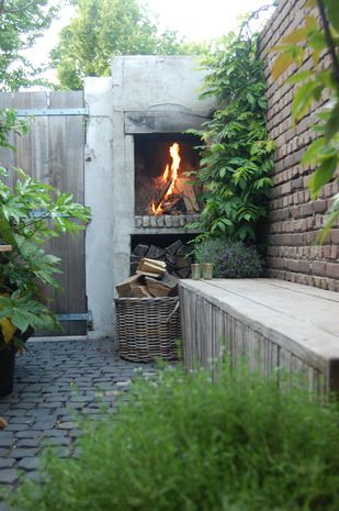 Modern rustic garden with outdoor fire