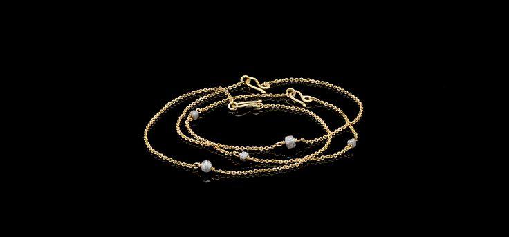 Gold bracelets and rough diamonds