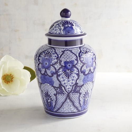 """Inspired by 14th century Chinese """"general jars"""" used to carry salt, spices, rice and ashes, our decorative ceramic temple jar delivers a mighty dose of Asian style. Hand-painted botanic patterns in cool shades of cobalt cover this <i>objet d'art</i> from foot to lid, resulting in a striking conversation piece that can stand alone or mingle with other jars of varying sizes."""