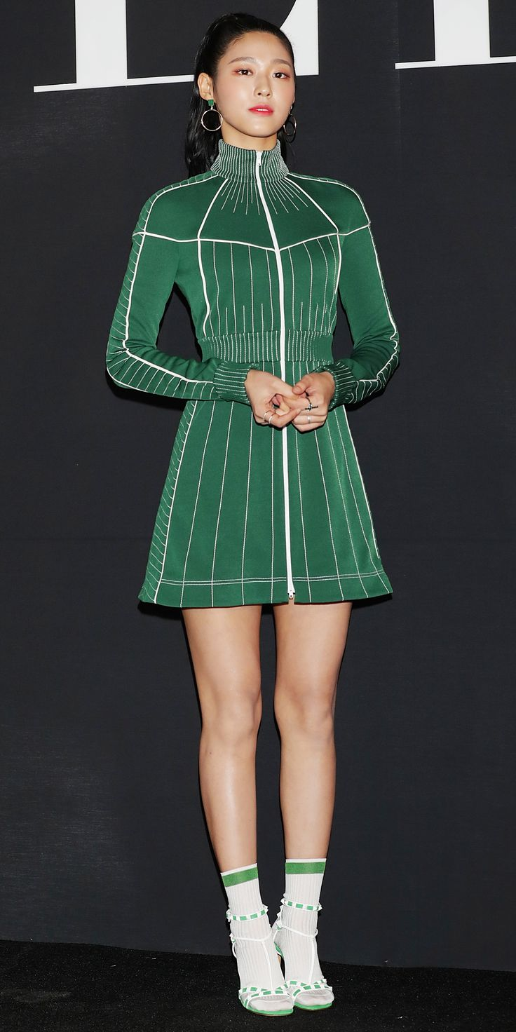 Seolhyun of the South Korean girl group AOA showed us her take on the athleisure trend while at Valentino's VLTN pop-up store opening. The singer sported an all green and white look consisting of a zip-up track dress and ultra-chic sandals with—yes—socks.
