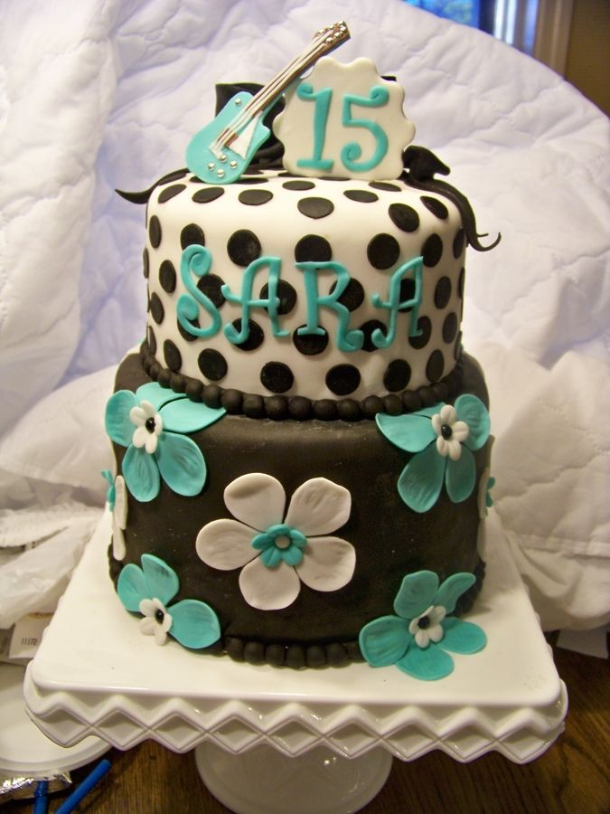 Top tier - chocolate with peanut butter icing, bottom tier - chocolate with buttercream. All decorations are fondant. Sara recieved a guitar for her special day and wanted a replica on her cake.