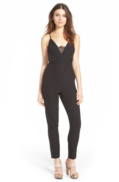 Free shipping and returns on MISSGUIDED Lace Panel Jumpsuit at Nordstrom.com. A gently nipped-in waist and tapered trousers have a leg-lengthening effect on a sultry black jumpsuit topped with a descending V-neckline detailed with a delicate inset of eyelash lace.<br /><br />