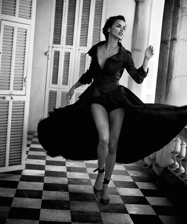 Adriana Lima makes a dramatic entrance in a Carolina Herrera trench gown in Harper's Bazaar