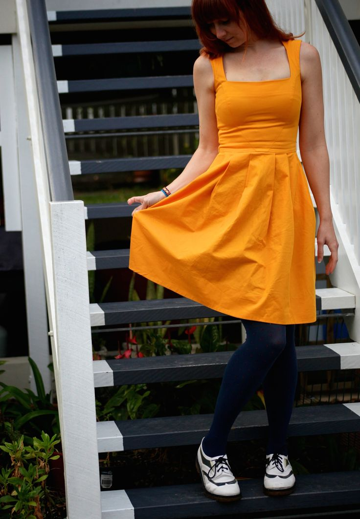 Navy blue tights work well with this Cue dress and Senso flats. #senso #womensclothing #yellow