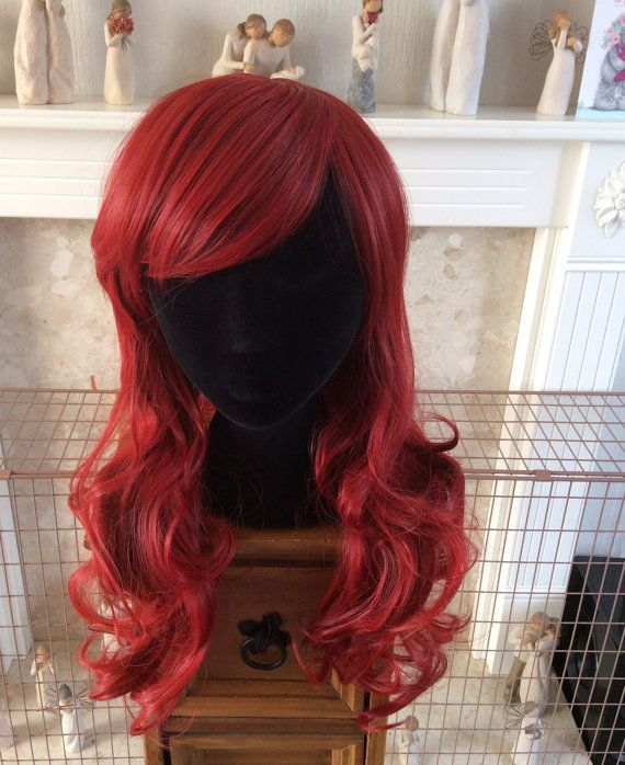 Here we have our Ariel inspired red wig. She is handmade so please allow 4-6 weeks for creation. The wig is approximately 26inch long when straight