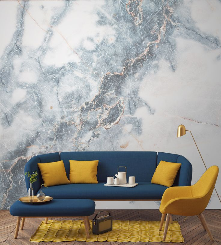 Create a decadent feature wall in your home with this marble wallpaper. A strike through of powder blues add drama and intrigue to your walls. Pair with darker furnishings to create the perfect living room space.