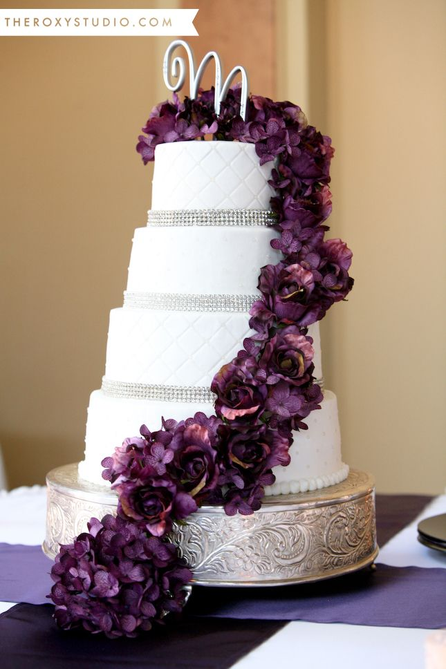 Photography by Samantha McGranahan, The Roxy Studio. Wedding photography, white and purple wedding cake, purple roses, bling wedding cake, white fondent wedding cake, letter cake topper
