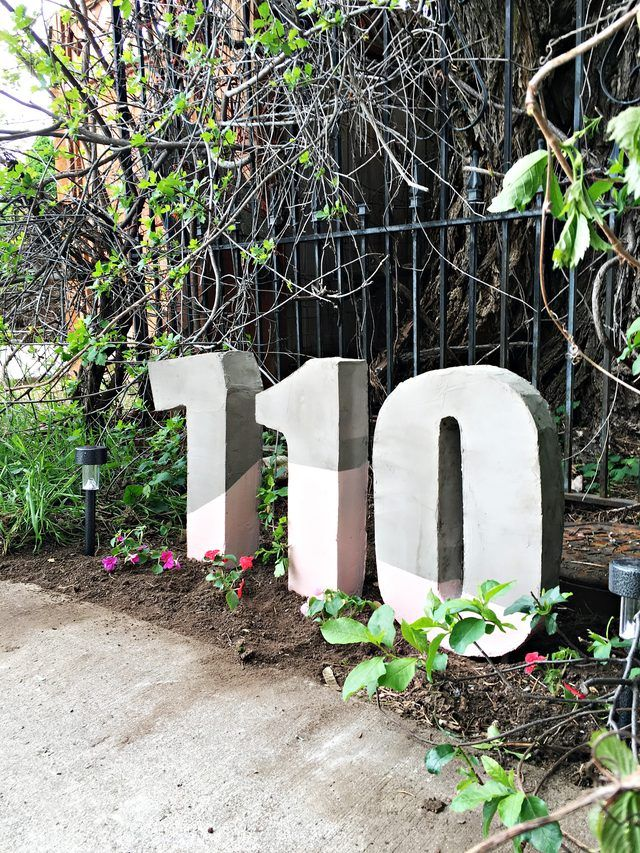 Oversize painted house numbers are pretty yard decorations that also make your house super easy to find. New friends and delivery drivers will thank you.