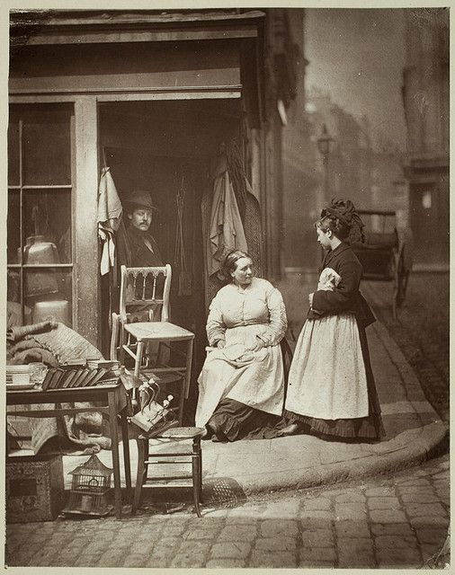 Victorian used/old furniture shop on a cobblestone street (complete with buggy in the background) as it looked in 1877. #Victorian #photograph #antique #vintage #shop #street #furniture
