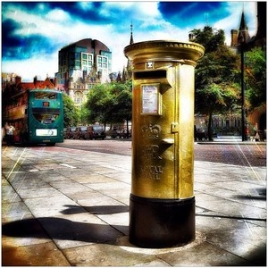 Manchester's Golden Post Box on Lloyd Street, painted gold in honour of 19 year old Philip Hindes,  who was one third of the gold medal winning trio in the cycling team sprint final at London 2012 Velodrome.