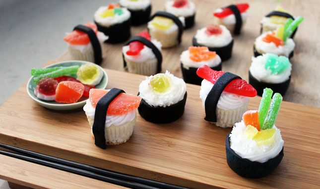 Sushi Cupcakes. For the fishy-looking components of these cupcakes, use Swedish Fish, sour straws, and orange slices.