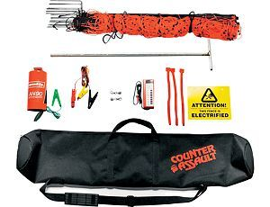 Counter Assault Pentagon™ Electric Fence - This fence uses high-quality components to protect you and your property with a battery-operated, lightweight orange elelctric mesh fence with 8,000 volts – 0.12 joules. It can run continually for 30-40 days. Everything you need to set up a 189-sq.-ft. secure area is included.