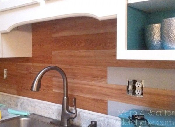 give your kitchen a new look with this super easy planked backsplash using peel and stick flooring - Cheap Kitchen Floor Ideas