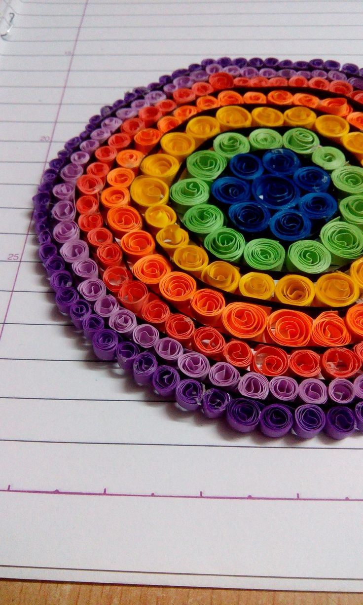 First attempt at quilling.. can be used to make a Dreamcatcher, coaster, or even wall decor.. This one is made with quilled circles stuck concentric circles. A quilling strip separates two different colours..
