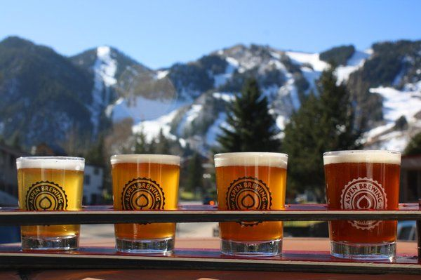 Photos for Yelp's Winter Break: Meet The Brewer with Aspen Brewing Company with Aspen Mountain in the background and Folsom Skis sample flight foreground | Yelp