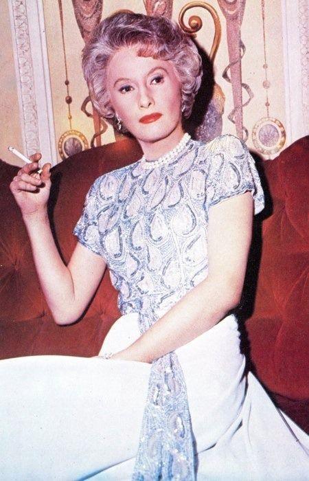 Barbara Stanwyck 50s era vintage fashion icon evening gown white grey short sleeves