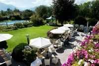 Sun terrace with view to the mountains at the Hotel Alpenhof Murnau, Murnau am Staffelsee, Germany