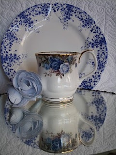 The cup is Blue Country Roses--I think--by Royal Doulton. Cousin to Old Country Roses
