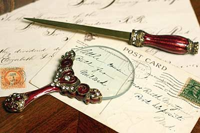 This site has multiple sets of letter opener & magnifying glass