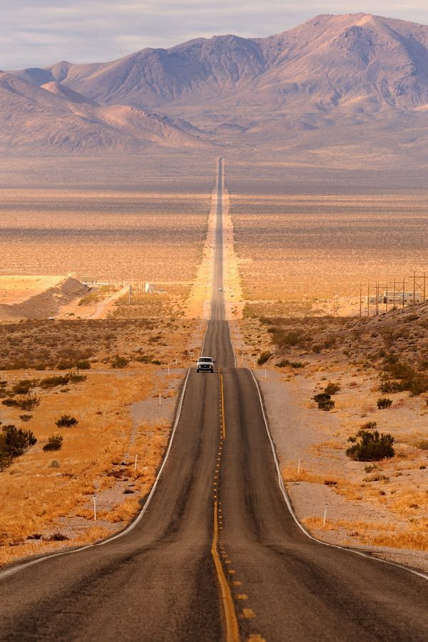 """Long desert highway leading into Death Valley National Park from Beatty, Nevada."" Photo by Glenn Nagel."
