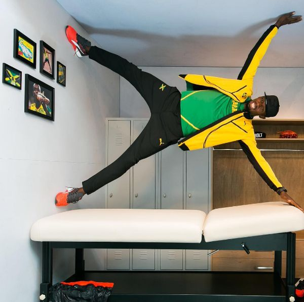 """This picture of Usain Bolt doing whatever this is:   20 Pictures Of Olympians That Will Make You Say """"Holy Shit"""""""