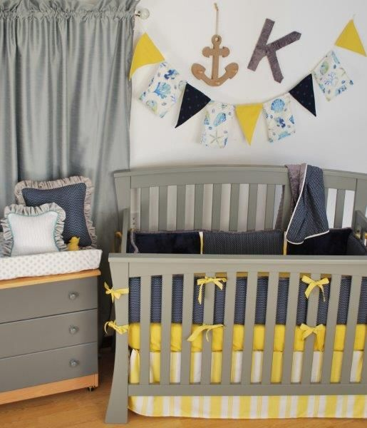 navy yellow grey crib bedding with a stripe dust ruffle and navy polka dots