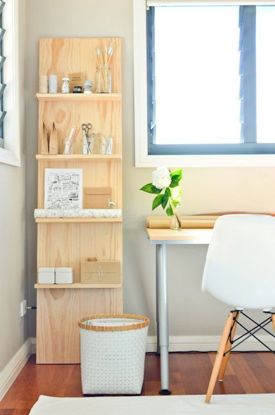 DIY Decor Trend: Handmade Storage Ladders - This would be perfect for the dorms since he can not hang anything and  this way he can use the vertical storage space.