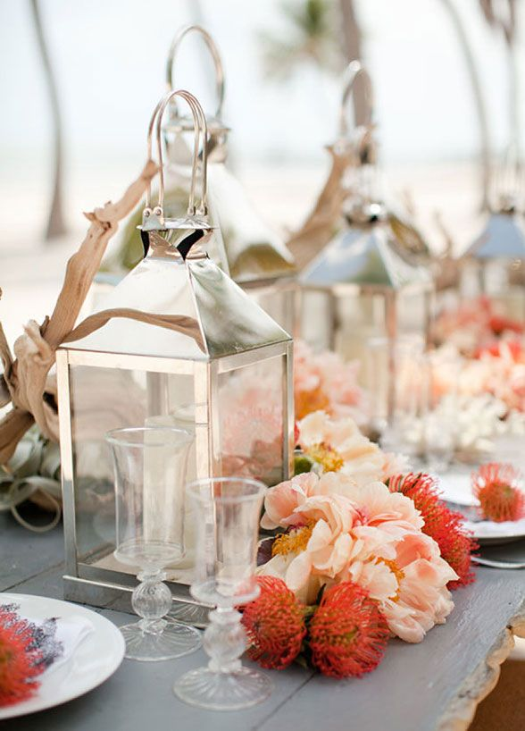 10 Ideas For Beach Weddings: #4. Light it up. Everything looks better in candlelight and a beach wedding is no exception. Hurricane lanterns and pillar candles will cast your décor in a mesmerizing glow.